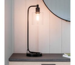 toja-black-industrial-table-lamp-with-glass-shade-switched-on-2